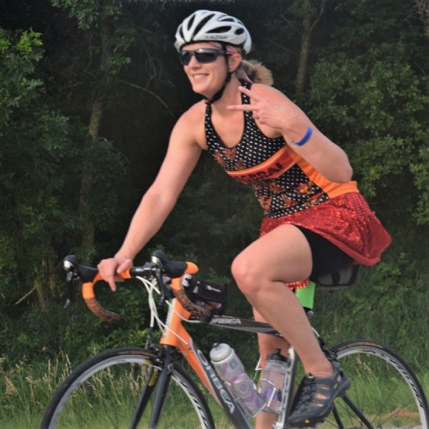 On this bike pic, looking through the summer archives, we found this biker chick riding into the Monday morning sun as she rode across Iowa on RAGBRAI this last summer.
