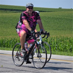 This Thursday bike pic, looking through the summer archive, we found this bike dude riding across Iowa, with with the sun shining brightly. See more fun photo on the RAGBRAI 2018 website.