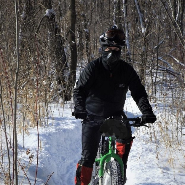 This Bike Pic  Tuesday as the temps continue to drop, we caught this biker dude, with plenty of layers and a mask having fun in the Bold North, near Bloomington, MN.