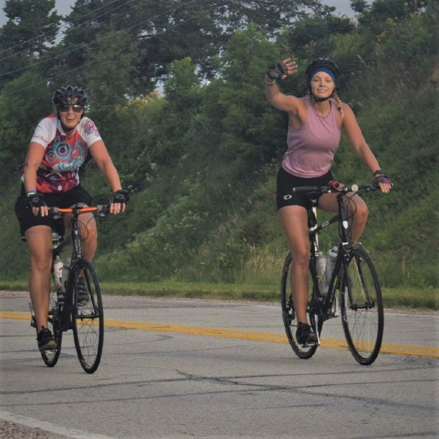 This Bike Pic Friday, with more warm weather ahead, we caught these two biker chicks, having fun, dancing on their pedals on RAGBRAI. What better way to continue your fun, finding y