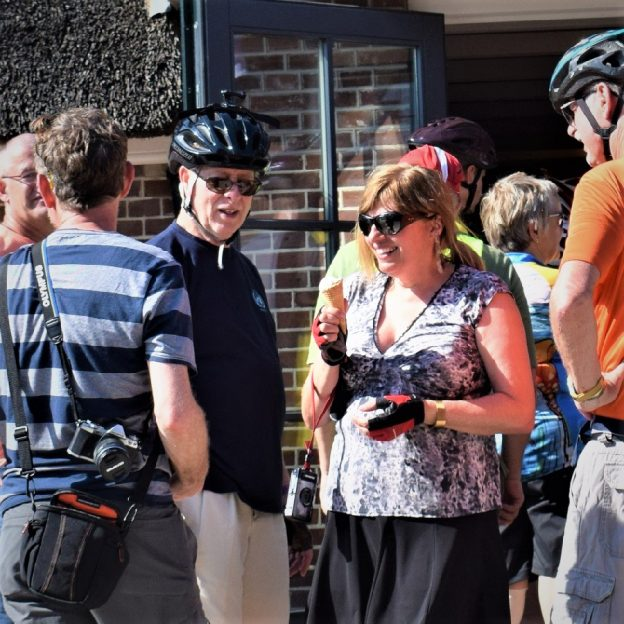On this bike pic Sunday, looking through the archives. We found this photo of a biker chick enjoying a tasty treat, surroundedby bikerdudes, on a bike/bikebarge trip in the Netherlandslast year.