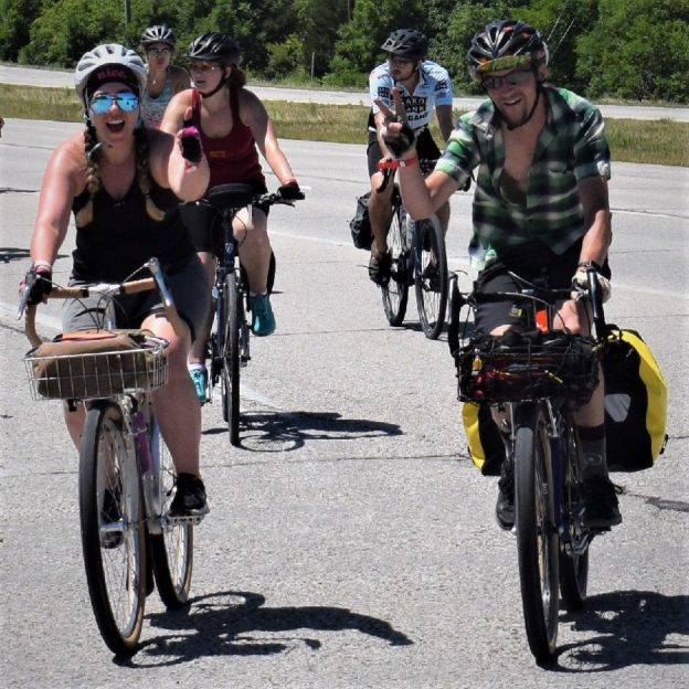 In this bike pic, looking through the summer archive, while the next lurks to the west, we found this bike chick and dude riding across Iowa with friends.
