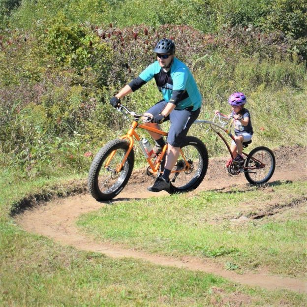 This Bike Pic Tuesday reflects on fond memories of family time out on the trail with the little ones. We found this biker dude bonding with his daughter,