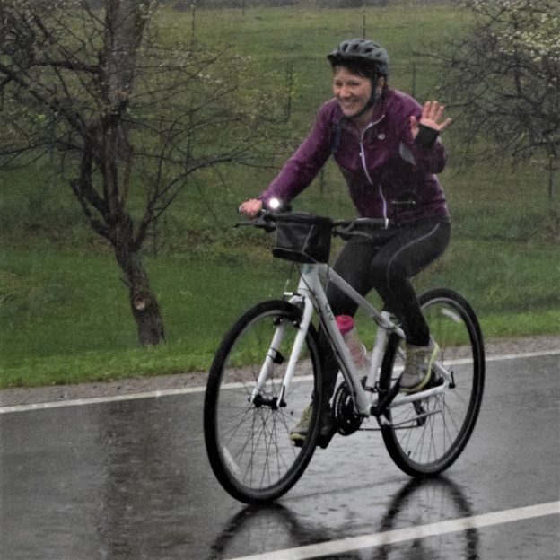 This Saturday bike pic shows a biker chick, having fun, riding in the rain and hoping for a sunny afternoon for her ride home.