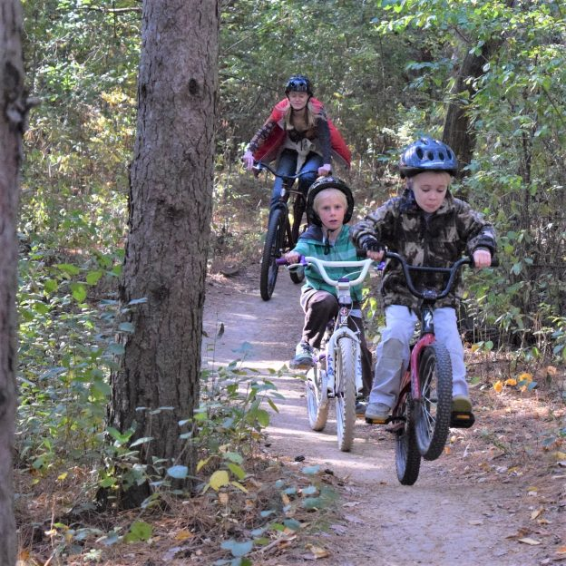 This wheelie Wednesday Bike Pic, we caught this family out having fun on the trail celebrating day three of 30-days of biking.