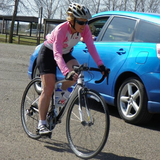 This Sunday bike pic shows a biker chick maneuvering around traffic on 28 of 30-days of biking for your personal commitment.