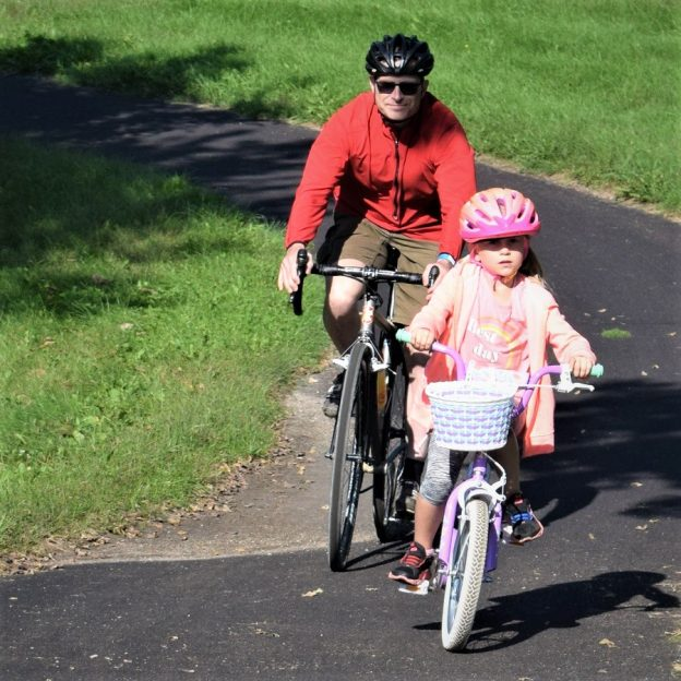 This Bike Pic, yeah it's Friday, we captured this biker dude out with his daughter enjoying some spring riding as the grass greens up.