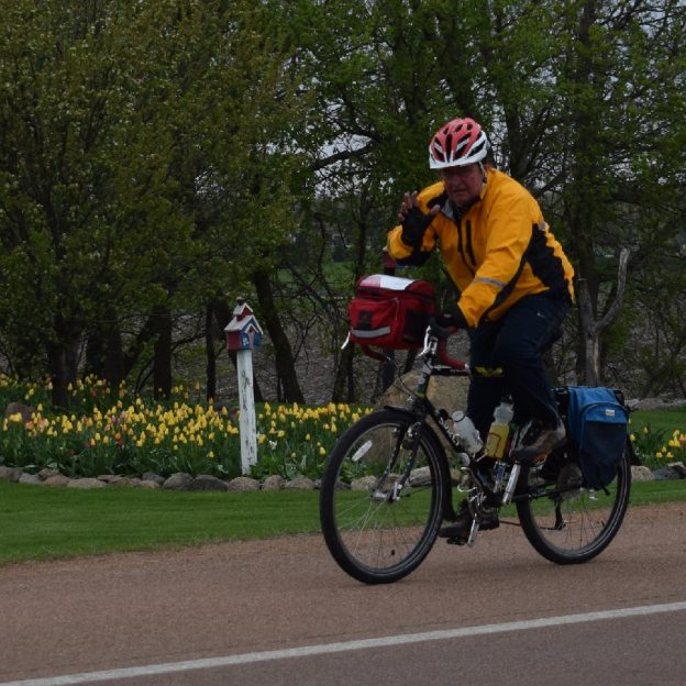 This Bike Pic Thursday, as trees are filling out and the tulips are popping, we caught this biker dude enjoying his surroundings.