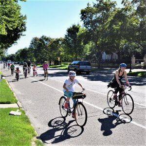 This Bike Pic Saturday, we captured these two biker gals out front of the group of cyclists, riding down Summit Avenue, in St Paul, MN for another True North experience.