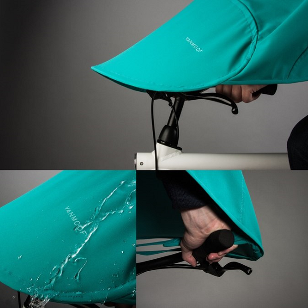 This bike poncho's extended section should cover the handlebars, protecting the wearer's legs and feet from the rain.(Credit: Vanmoof)