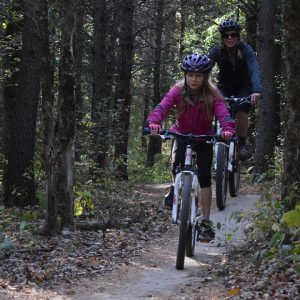 A sunny spring afternoon, this mother-daughter  mountain bike team is creating some fun memories in the Pillsbury State Forest near Brainerd, MN.