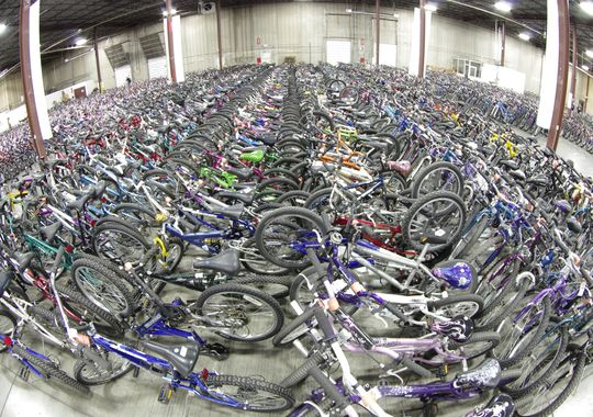here in the Northeast Minneapolis warehouse , over 5,000 bikes were collected, cleaned and/or repaired for the 2014 program. (Photo: Terry Esau)