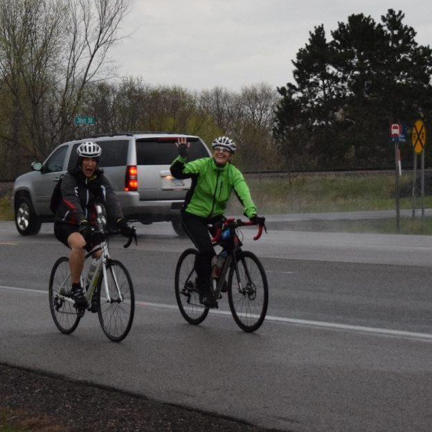 Having fun in the rain on the Ironman Sunday bike ride these two ladies are ready a summer memories.