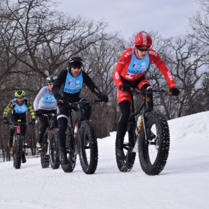 Here the four top fat bike contenders of the 2016 Penn Cycle Fat Tire Loppet battle early and often for position on the 35K race course in Minneapolis. MN that started in Theodore Wirth Recreational Area, then meandered around the Lake of the Isles, before rounding Lake Calhoun, for the finish.
