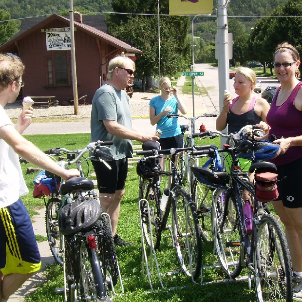 Here in Peterson, MN, a great bike rest stop, a group of cyclist, last summer, enjoyed a ice cream smiles moment.