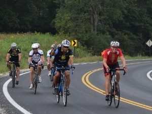 Bike riders on the scenic roads in Bluff Country, near Houston, one of the  Root River Trail Towns in Minnesota.