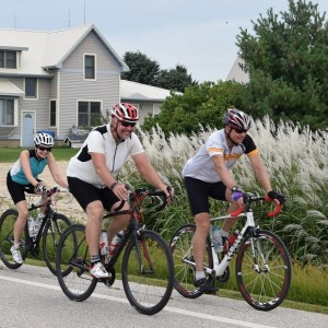 Here a group of cyclists enjoy exploring the scenic roads by bike, that circle and cross the Root River Trail, in Southeast Minnesota's Bluff Country. Ride and explore the areas trail and roads, July 9 -11, 2016 on the Root River Bluff & Valley Bike Tour.