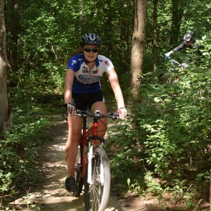 Here on her mountain bike is a MN High School Cycling League team member practicing in Lebanon Park, in Eagan, MN.