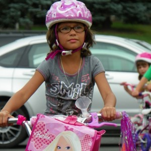 Here, this young lady shows off here new bike after finishing a bike rodeo at her school in Albert Lea, MN, this last summer.