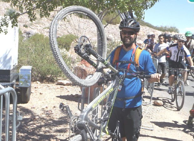 Here a mountain biker walks his bike back to the trailhead after missing a technical turn along the trail.