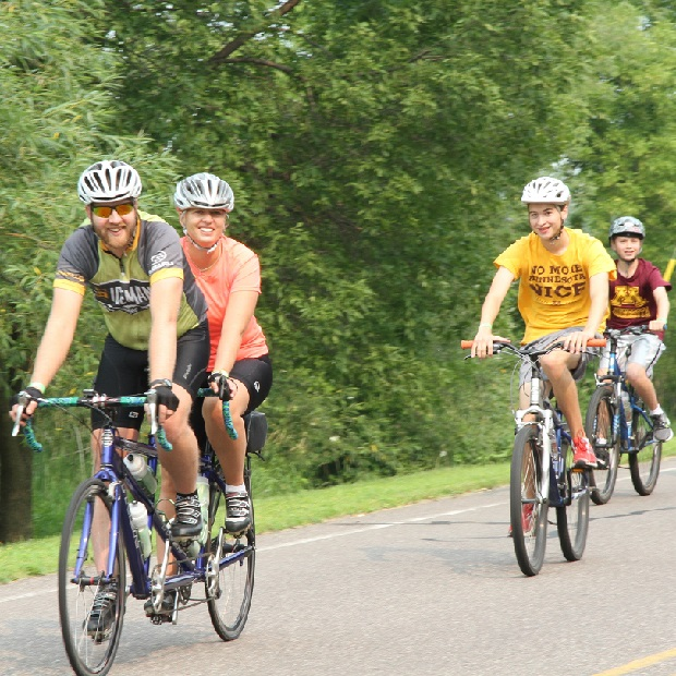 Here a family of cyclists enjoy exploring the scenic roads, by bike, that circle and cross the Root River Trail, in Southeast Minnesota's Bluff Country.