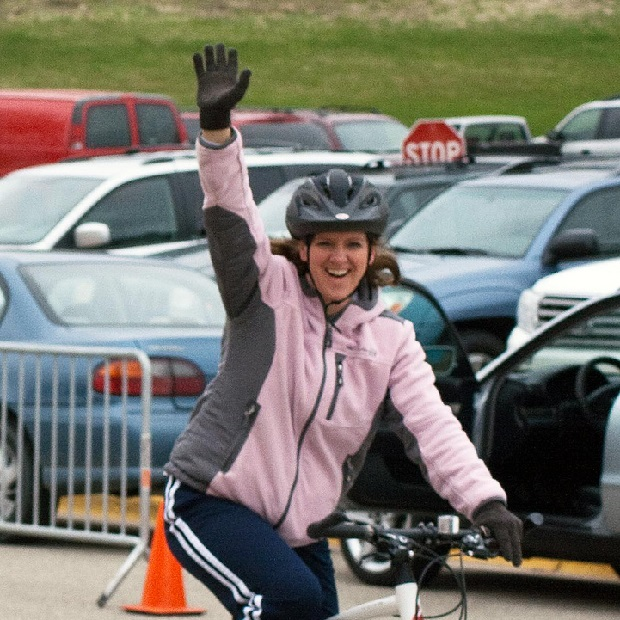 Here is one excited lady, on her bike, waving after hearing the news about the 2016 MN Ironman's registration now open.