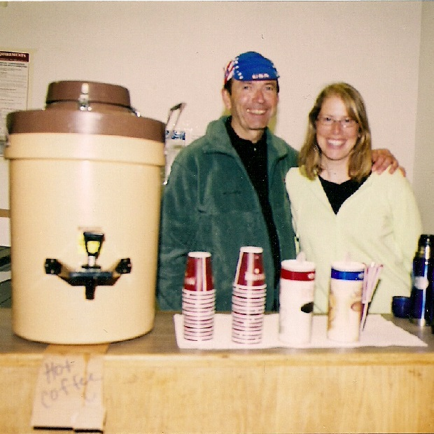 A Minnesota Ironman volunteer tradition, always serving food and drinks at rest stops with a smile.