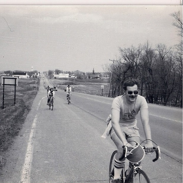 A wave of Minnesota Ironman bike riders in the 60's heading north on the original century route.
