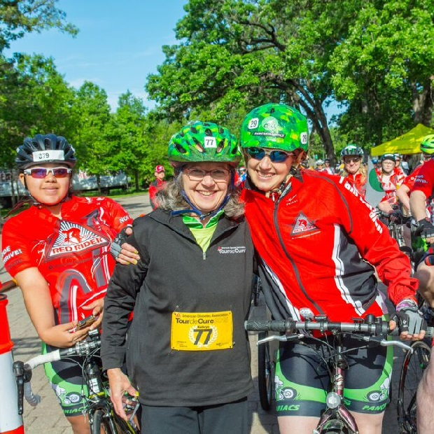 These Twin City Tour d' Cure bike participate pause at the end of last years ride for a photo opp. by Coppersmith Photographers