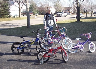 Rick with some of the kids bike he has available.