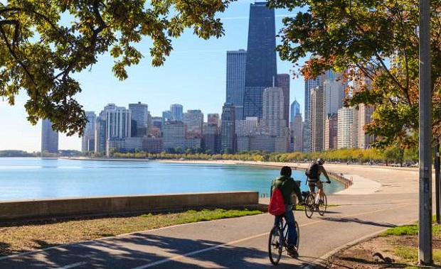 Cyclists riding along Lake Michigan shore with the Chicago skyline beyond, source   TIME Magazine