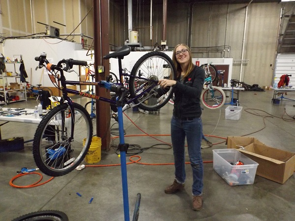 Volunteering and putting a wrench to a few bikes will create more smiles.