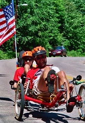 Father and son riding with Old Glory waving in the breeze. (2012)
